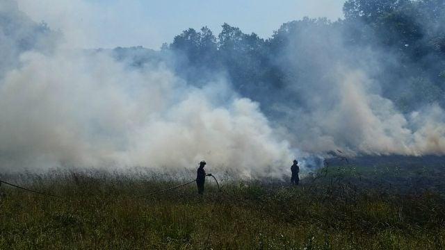 Firefighters battle brush fire at in West Rock Ridge State Park in Hamden. (Hamden Fire Department)