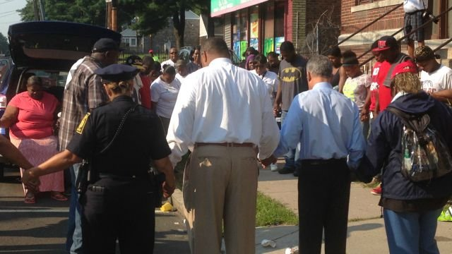 People joined hands and prayed for Jackson's safe return. (WFSB)