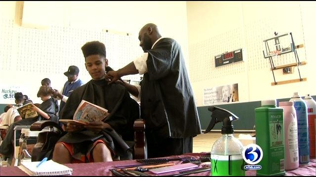 Students get free haircuts at Wilson-Gray YMCA on Monday. (WFSB)