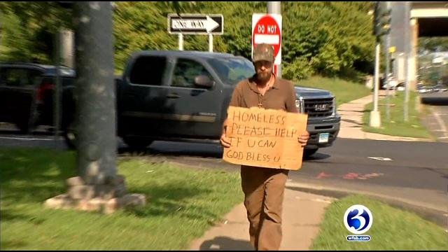 Homeless man panhandles for money in Enfield. (WFSB)
