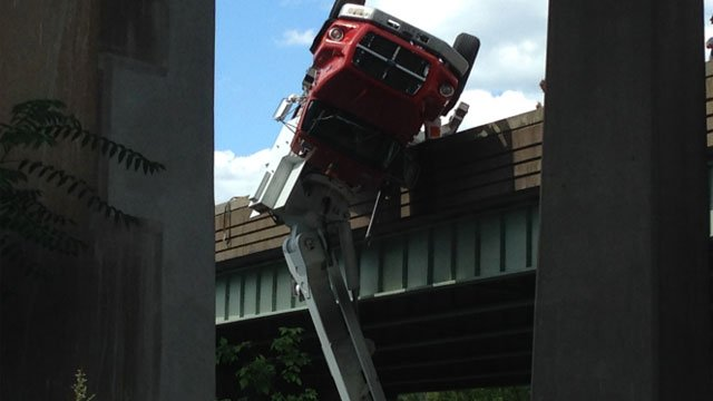 This tractor-trailer was spotted dangling over Trout Brook in West Hartford. (WFSB)