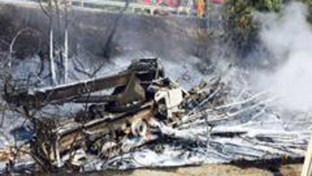 The charred remains on the tractor trailer. (State police photo)