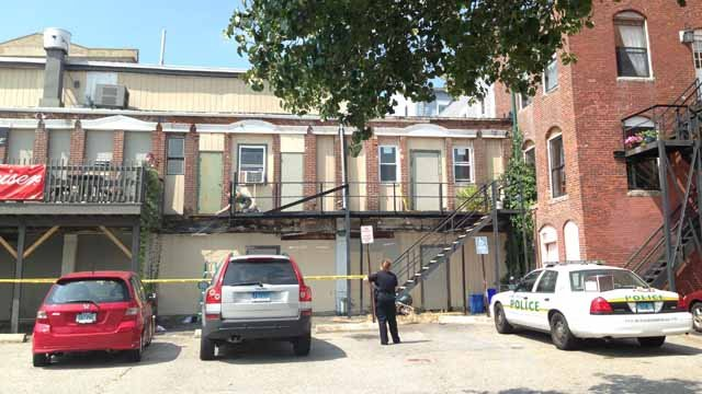 Police on the scene behind the Lost Soul Tattoo business in New London. (WFSB photo)