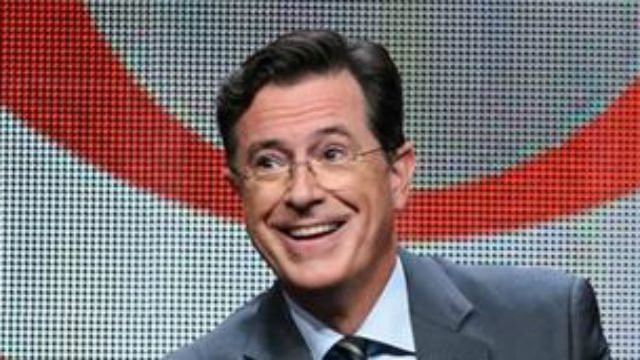 "Photo by Richard Shotwell/Invision/AP, File). FILE - In this Aug. 10, 2015, file photo, Stephen Colbert participates in ""The Late Show with Stephen Colbert"" segment of the CBS Summer TCA Tour in Beverly Hills, Calif."