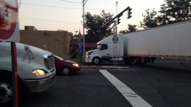 Trucks performing u-turns on side streets in New Haven also caused delays. This one struck a sign, according to an Eyewitness News crew on the scene. (WFSB photo)