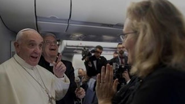 In this Tuesday, July 23, 2013 file photo, Pope Francis jokes with Associated Press correspondent Nicole Winfield on aboard the papal flight heading to Rio de Janeiro, Brazil.  (L'Osservatore Romano/Pool Photo via AP, File)