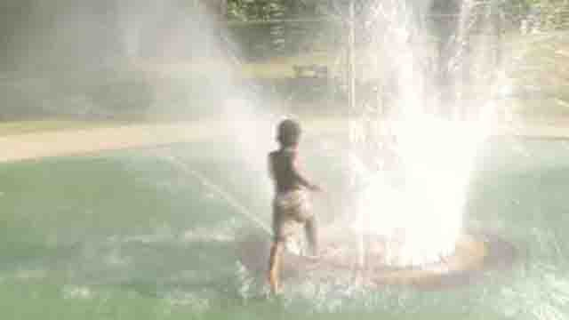Waterbury residents beat the heat with city splash pads, sprinklers (WFSB)