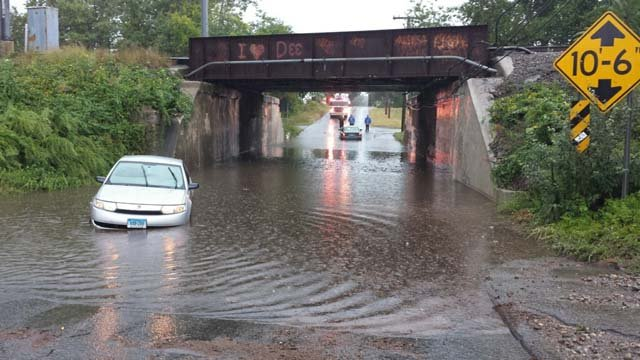 Flooding reported under the Poquonnock Bridge on South Road in Groton (WFSB)