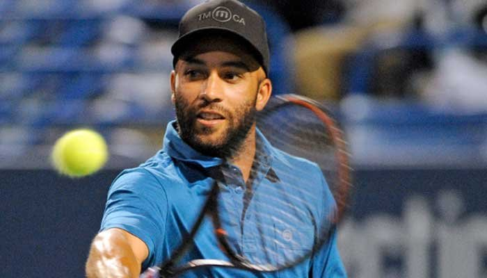 Former tennis pro James Blake, who is biracial, said the officer who put him in handcuffs inappropriately used force. (Source: AP Photo/Fred Beckham )
