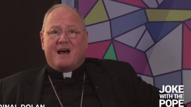 Cardinal Timothy Dolan tries his hand at making the Pope laugh. (CBS NEWS)
