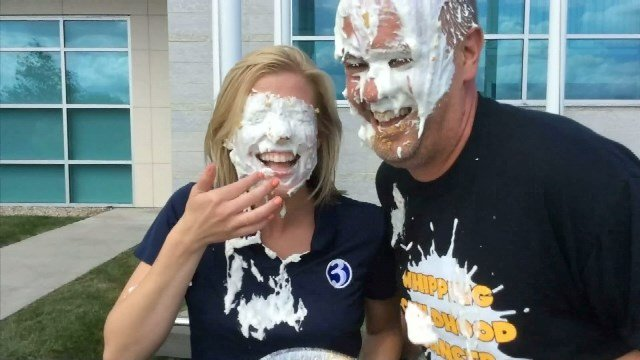 Nicole Nalepa and editor Tom Zukowski took pies to the face to whip childhood cancer. (WFSB photo)