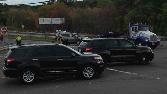 """A """"serious"""" motor vehicle crash closes the Berlin Turnpike in both directions in Newington. (WFSB)"""