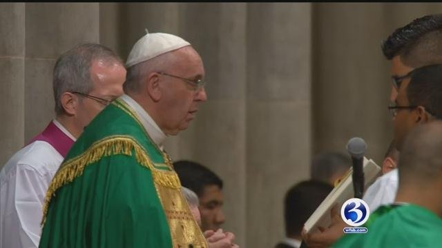 Pope Francis leads mass in New York. (CBS)