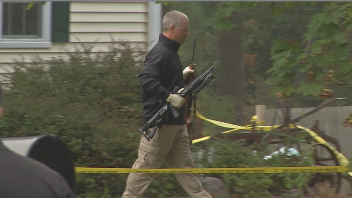 Police were seen removing firearms from the home where a woman's body was found. (WFSB photo)