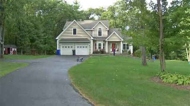 An Ellington family fears their front yard is about to disappear after a proposed construction project would wipe out part of their property. (WFSB)