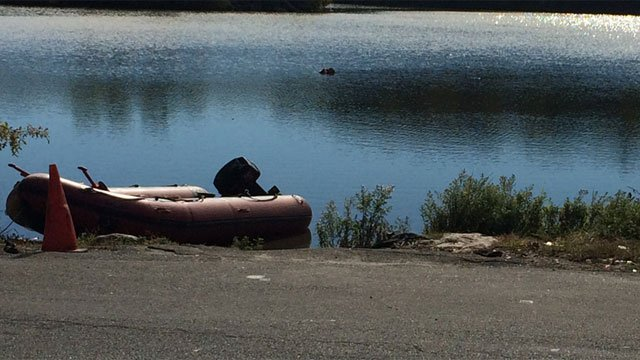 Crews were called to a report of a car in Lakewood Lake just off of Farmwood Road in Waterbury. (WFSB)