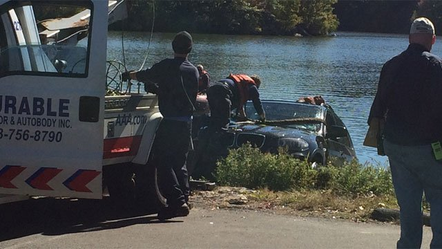 Crews pulled a motor vehicle in Lakewood in Waterbury. (WFSB)