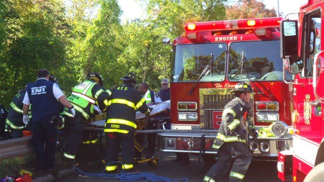 Crews rescue to help crash victims after a SUV went down an embankment. (Norwalk Fire Department)