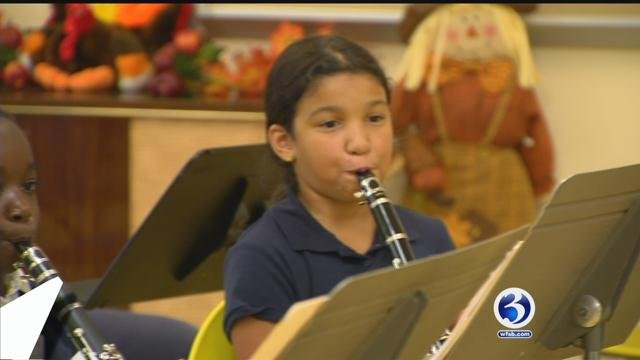 Students at the Chamberlain and Vance elementary schools play their new instruments. (WFSB)