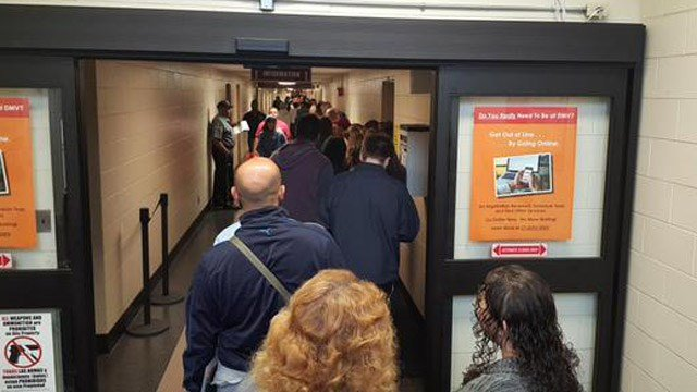 Photos of people waiting in line at the Department of Motor Vehicles. (iWitness photo)