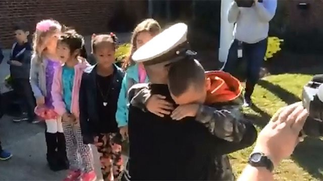 Chief Petty Officer Ned Deshong surprises his son at Edna C. Stevens School in Cromwell on Thursday. (WFSB)
