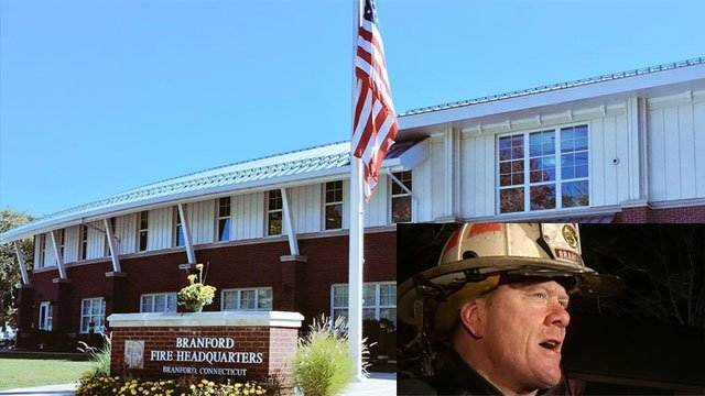 Flags were lowered at Branford Fire Department after the death of deputy chief Ron Mullen. (WFSB)