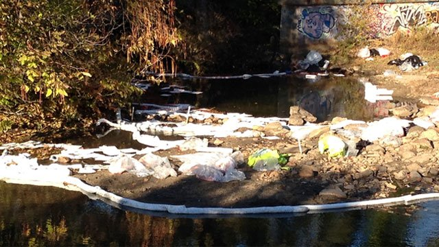 DEEP crews work to cleanup the Great Brook in Waterbury after a fuel spill. (WFSB)