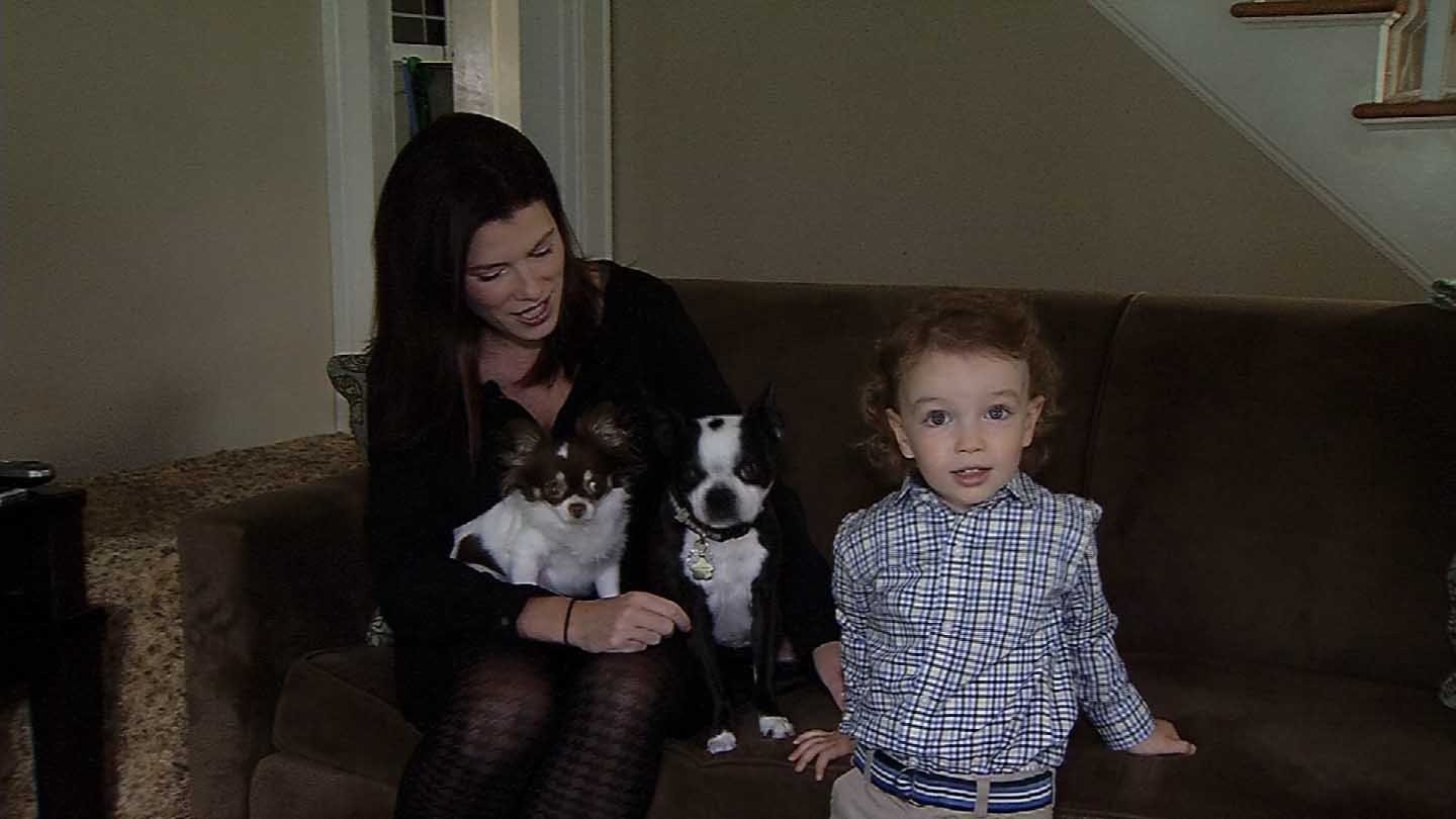 Kristen Shannon and 2-year-old Fergus Shannon with two of their three dogs. (WFSB photo)