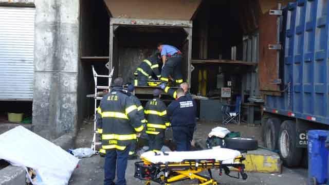 Man injured after falling into trash hopper at Norwalk transfer station (Norwalk fire crews)