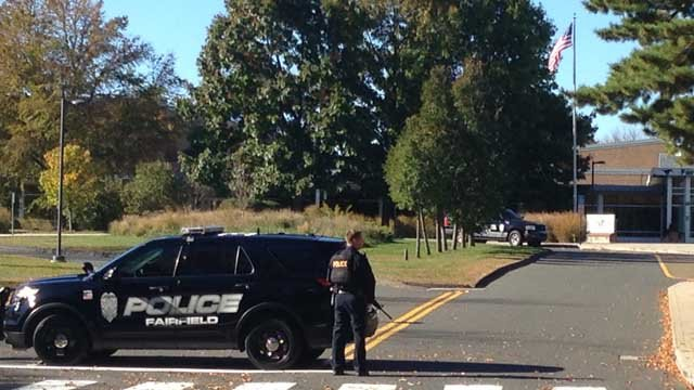 Police outside of the Fairfield Warde High School. (WFSB photo)