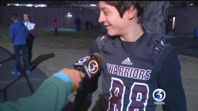 Nathan Mascola shows off his jersey after being part of the Windsor High football team on Friday. (WFSB)