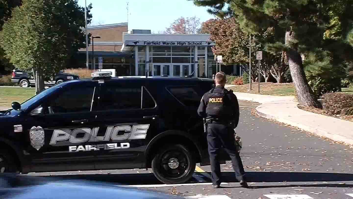 Police stationed outside of Fairfield Warde High School on Friday. (WFSB photo)