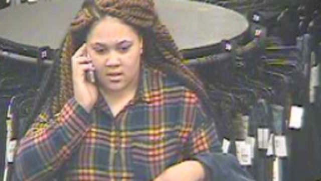 Police released this photo of the woman accused of stealing clothing from Clinton Crossing Outlets. (Clinton Police Department)