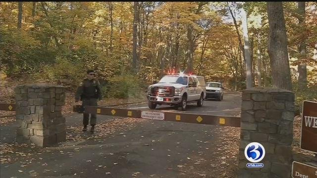 Crews working early Monday morning to recover the hiker's body. (WFSB photo)