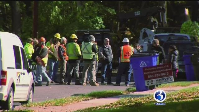 Crews speak with neighbors about a controversial tree removal project in West Hartford. (WFSB photo)