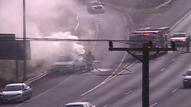 Firefighters battle car fire on I-84 in West Hartford. (DOT)
