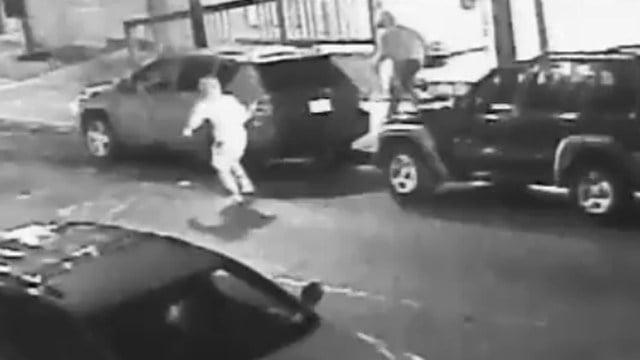 Three suspects can be seen fleeing a murder seen in this surveillance photo. (Bridgeport police photo)