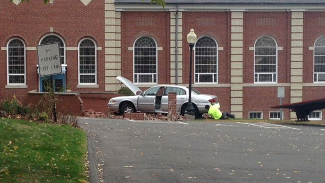 A car crashed into the walkway at Corpus Christi Church in Wethersfield. (WFSB)