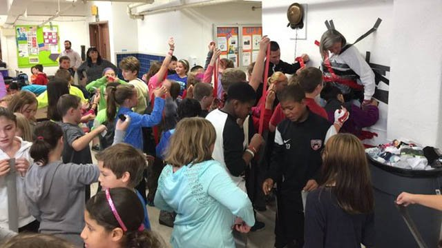 Teacher duct-taped to wall for good cause (WFSB)