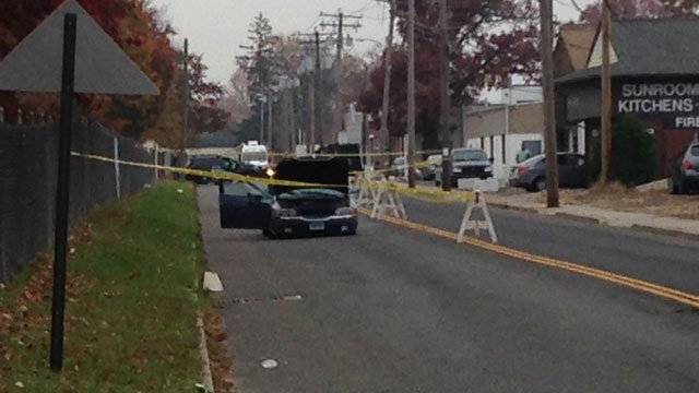 Two officers were injured in a motor vehicle crash on Surf Avenue in Stratford. (WFSB)