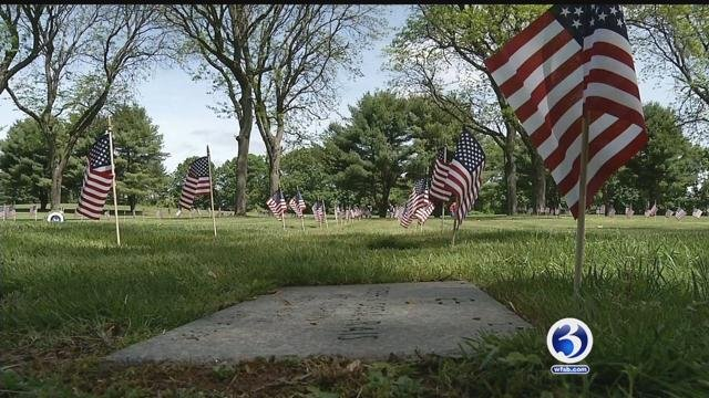 American flags to be placed on grave stones at Fairview Cemetery in West Hartford. (WFSB)