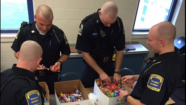 State police recruits sorted through donated leftover candy. (@CT_STATE_POLICE)