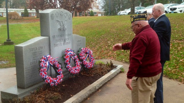 Wreaths were placed at a memorial in Newington on Wednesday. (WFSB)