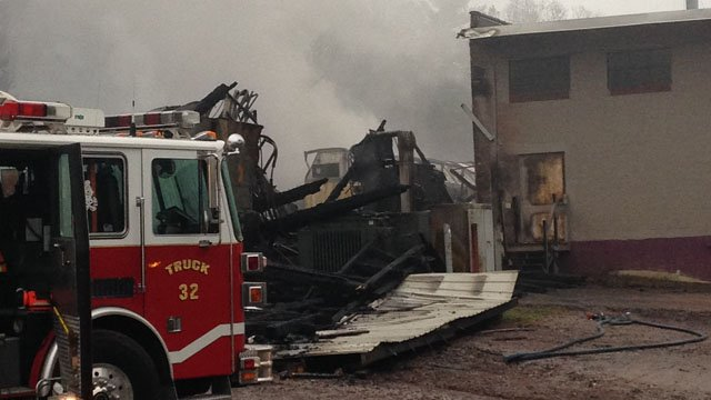 A manufacturer fire continued to smolder on Thursday. (WFSB photo)