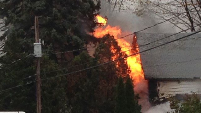 """The fire was """"fully involved"""" when firefighters arrived on scene.  (WFSB)"""