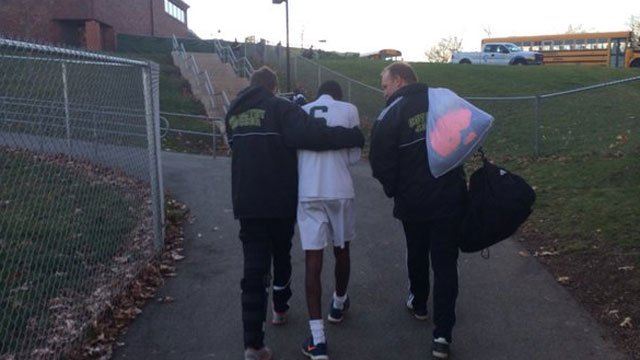 Noah Zajac supports Kwabena Obiekwu after the Coventry Boys' soccer team lost 3-2 to Somers on Saturday. (WFSB)