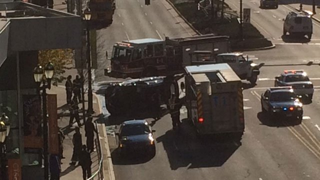 A car was on its side after a crash near the Connecticut Science Center in Hartford on Tuesday. (WFSB)