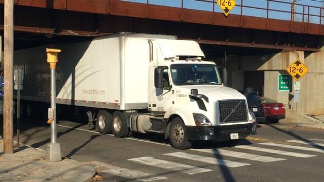 Tractor trailer got stuck under railroad bridge in Milford off River Street. (WFSB)