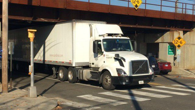 Tractor trailer got stuck under railroad bridge in Milford off River Street. (WFSB)