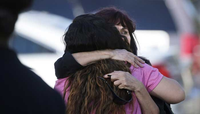 Teresa Hernandez, facing camera, is comforted by a woman as she arrives at a social services center in San Bernardino, CA, where one or more gunmen opened fire, shooting multiple people on Dec. 2, 2015.  (Source: AP Photo/Jae C. Hong)